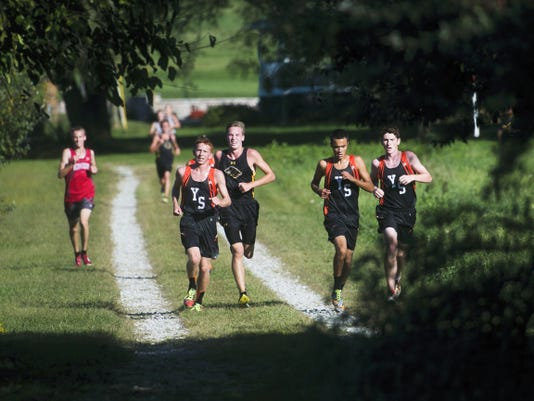 York Suburban's Peter Wagner, left, Donovan Mears, middle, and Bryce Ohl, right, lead the boys' cross country meet on Tuesday at Fairfield Area High School. Wagner placed first, Ohl second and Mears third, as the Trojans swept the team event.