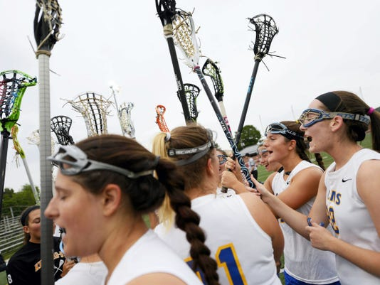 Kennard-Dale's Morgan Day, right, cheers with her teammates as they take the field for Thursday's District 3 tournament third-place game against Susquehannock at Lower Dauphin Middle School in Hummelstown. Day scored six goals to broke the national career scoring record for girls' lacrosse, helping her team beat Susquehannock, 15-11. The win advances the Rams to the PIAA tournament, where Day will look to add to her record of 465 career goals.