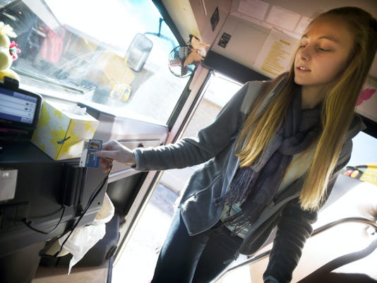 Elco student Jalissa Nolt swipes her student ID card as she boards the bus at the end of the school day recently.