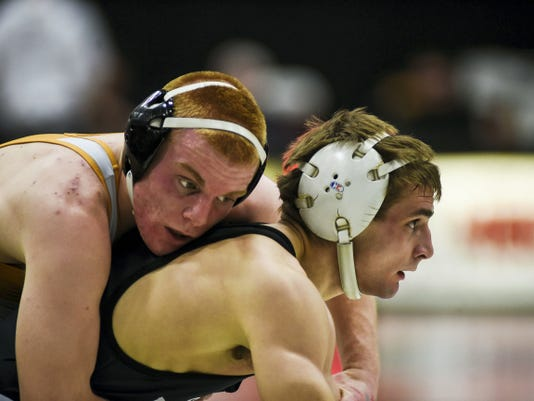 South Western's Clint Wright is held on top by Central York's Steven Clawson in a 145-pound bout during the District 3 Class AAA Section V wrestling tournament Saturday at South Western High School. Wright placed second in the 145-pound weight class, one of seven South Western wrestlers to advance to the District 3 tournament.