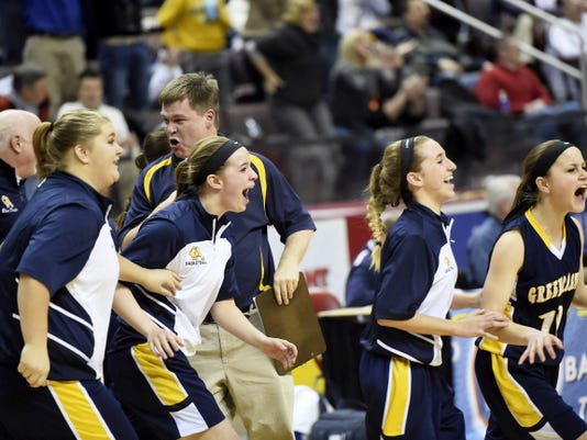Greencastle's bench rushes the floor after a 42-40 win against undefeated West York during the District 3 AAA girls basketball semifinal on Wednesday, February 25, 2015. Ryan Blackwell - Public Opinion