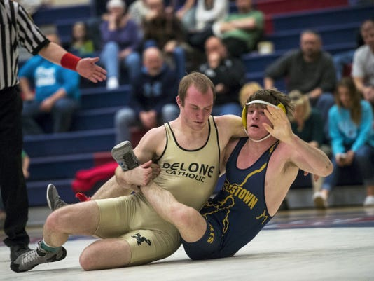 Delone's Lucas Shull tries to control Littlestown's Adams Smith during the YAIAA All-Star wrestling meet at Spring Grove High School on Tuesday. Shull won the bout, 12-6.