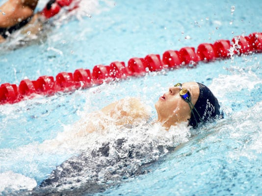 Lauren Ellis of Chambersburg swims the first leg, the backstroke, of the girls 200 medley relay during the District 3 Class AAA Swimming Championships on Friday. The team finished 11th, but set a school record of 1:52.97.