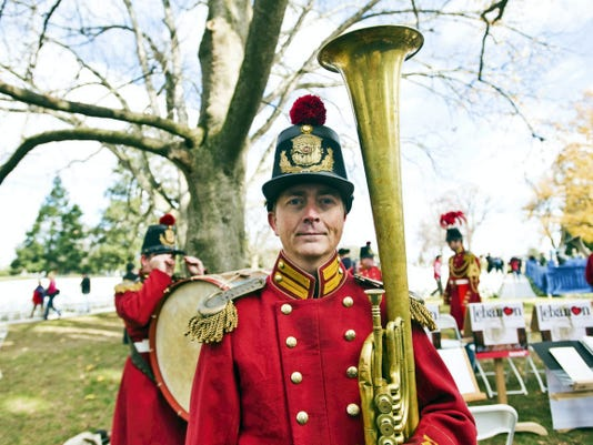 David Centers of 'President Lincoln's Own Band' stands with his B-flat tenor horn Tuesday. The band is from Lebanon, Ky. and was featured in Stephen Spielberg's movie, 'Lincoln.'