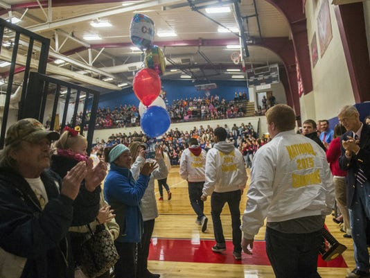 New Oxford High School's cheerleading team enters the gym where the student body is gathered in celebration Feb. 9.
