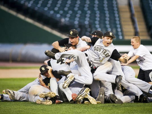 Delone Catholic baseball players celebrate after beating Kutztown, 4-0, to win the District 3 Class AA championship at Sovereign Bank Stadium in York on May 29, 2013. It was the first district championship for the Squires after five runner-up finishes.