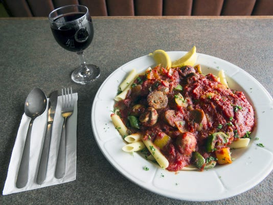 City Pasta, sautéed chicken and sausage with mushrooms, onions, bell peppers, and hot pepper flakes with marinara sauce. tossed with penna pasta at Marino's Pizza and Pasta House in Springettbury Township Wednesday March 4, 2015  Paul Kuehnel - Daily Record/Sunday News