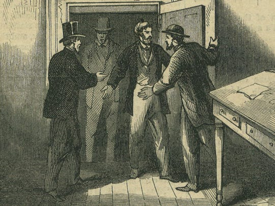 Cashier Marcas W. Beardsley and Jackson Clark, a woodsawyer who was in the Franklin County Bank, are freed from the vault. They understood the Confederates planned to burn the town and feared for their lives by suffocation or fire. J. Russell Armington and Dana R. Bailey heard their shouts and came to their rescue.