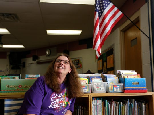 Kris  Kunkel, a second grade teacher at Bannach Elementary School in Stevens Point for more than 30 years, poses for a portrait in her classroom August 25, 2016. Kunkel has had a foster grandparent in the classroom the entire time she's taught in the district, and sees the program as vital to children's education. The program is facing being cut.