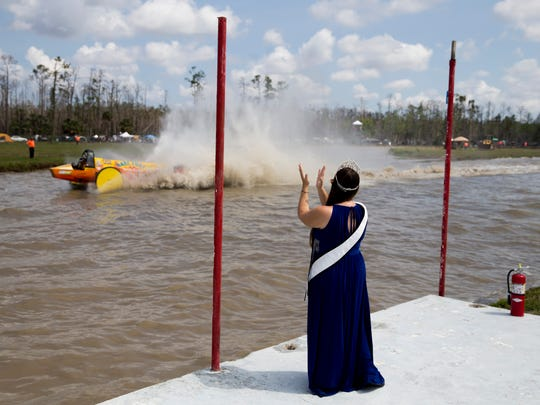 Swamp Buggy Queen Erica Flesher cheers on her sponsor, Pro-Modified racer Bobby Williams, as he races during the season finale at Florida Sports Park Sunday, April 8, 2018 in Naples.