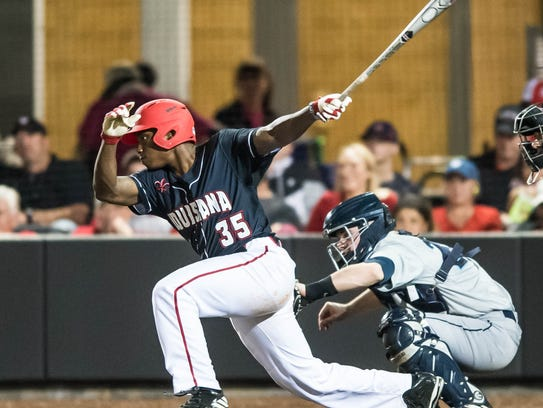 UL Ishmael Edwards makes contact for the base hit on