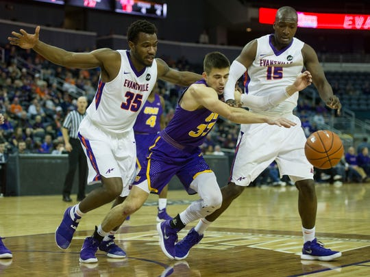 University of Evansville's John Hall (35), Northern Iowa's Wyatt Lohaus (33) and University of Evansville's Dalen Traore (15) go after a loose ball in the first half at the Ford Center on Wednesday, Jan. 31, 2018. The Purple Aces defeated the Panthers 57-49.