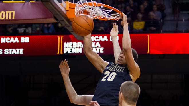 Purdue center A.J. Hammons dunks in the first half.