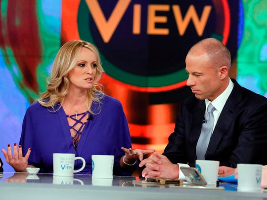 """Adult film actress Stormy Daniels and her attorney Michael Avenatti appear on the daytime talk show """"The View,"""" on April 17, 2018 in New York."""