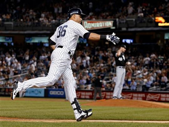 New York Yankees' Carlos Beltran rounds the bases after
