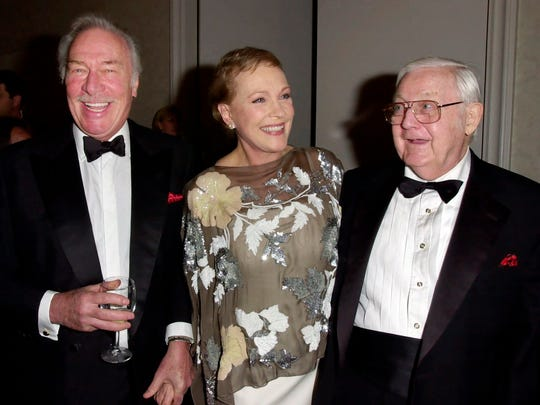 """In this April 25, 2001 photo, Julie Andrews (C) is joined by Christopher Plummer (L) and """"The Sound of Music"""" director, Robert Wise, during a reception for the event where Andrews received the ELLA award in Beverly Hills, Calif."""