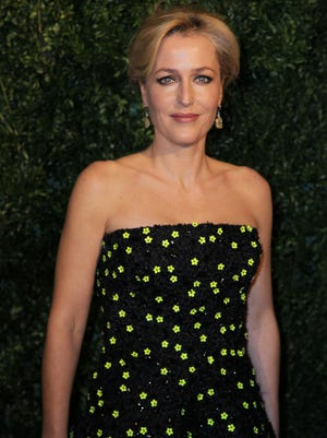 Gillian Anderson poses for photographers on arrival at the Evening Standard Theatre Awards, on Sunday Nov 30, 2014 in Central London.