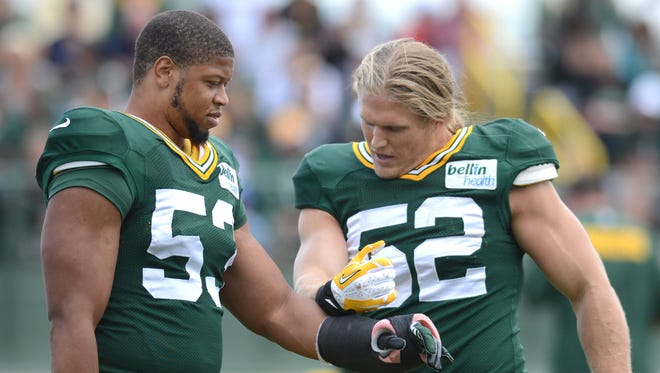 Green Bay Packers linebackers Nick Perry, left, and Clay Matthews during a 2013 training camp practice at Ray Nitschke Field.