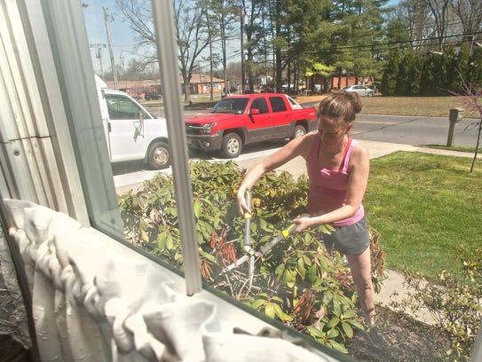 Elizabeth Quam works on a home in Glassboro. Quam is