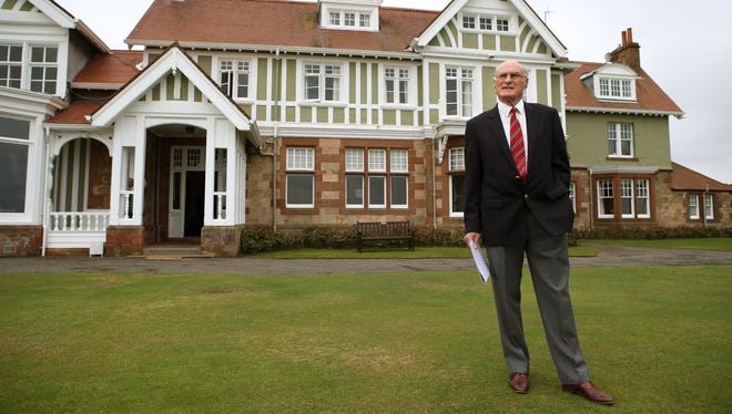 Henry Fairweather stands in front of the Muirfield clubhouse.