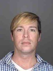 Christopher Schraufnagel's booking photo. He was charged