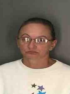 Catherine Cornett: Accused of bilking elderly couple of $8,500.