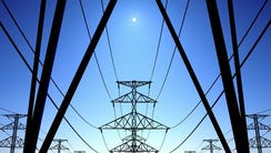 Transmission towers and lines carrying electricity.