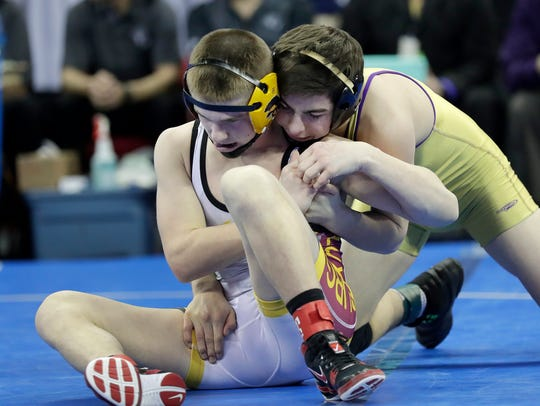 Bryce Bosman of Luxemburg-Casco battles Joey Bianchi of Two Rivers in the 126-pound Division 2 final Saturday at the Kohl Center in Madison.