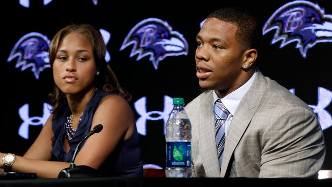 Baltimore Ravens running back Ray Rice, right, speaks alongside his wife, Janay, during a news conference at the team's practice facility in Owings Mills, Md. A new video that appears to show Ray Rice striking then-fiancee Janay Palmer in an elevator last February has been released on TMZ Sports.