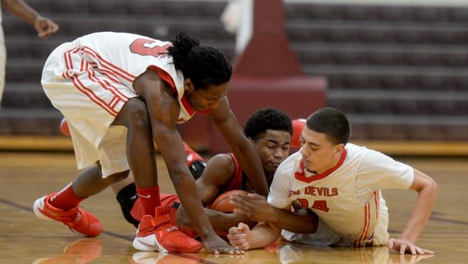 Richmond's Tyrone Washington, left, and Daric Clemens go after the ball with Portage's Keyante Hayes during a basketball game in the 9th Annual Bob Wetting Memorial Tournament Wednesday, Dec. 30, 2015 at Earlham College.