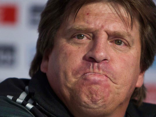 File - In this Dec. 6, 2013, file photo, Mexico's head coach Miguel Herrera listens to a question during a press conference at the national team's training center in Mexico City, after the final draw in Brazil for the 2014 World Cup.  Herrera, who said last May 2014, that he expects his players to refrain from any horizontal samba during their stay in Brazil, where the monthlong tournament opens next week. (AP Photo/Christian Palma, File)