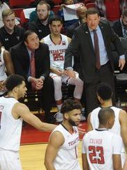 Texas Tech coach Chris Beard talks to his team during