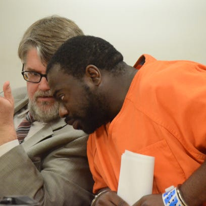 Attorney Niels Magnusson talks with his client, Jerrell