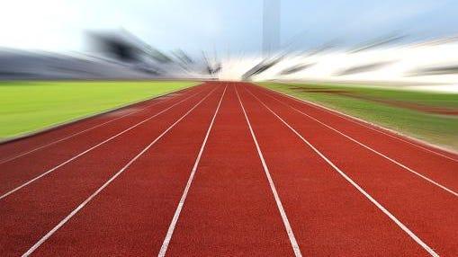 Running Track At A Sport Stadium (radial blur up image)