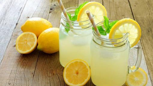 Two mason jar glasses of homemade lemonade