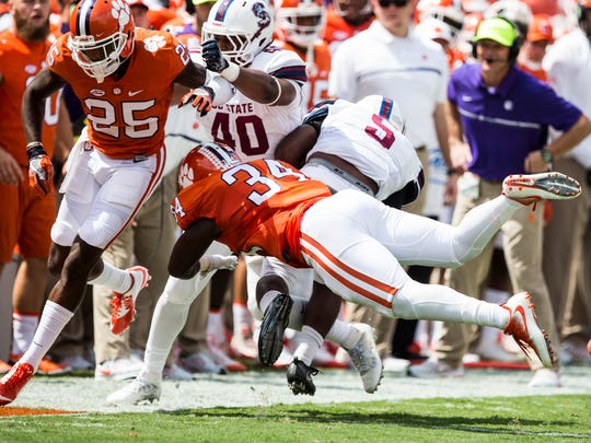 Clemson linebacker Kendall Joseph (34) tackles SC State running back LeBron Morris (5) during the Clemson game against South Carolina State on Saturday, September 17, 2016 in Clemson.