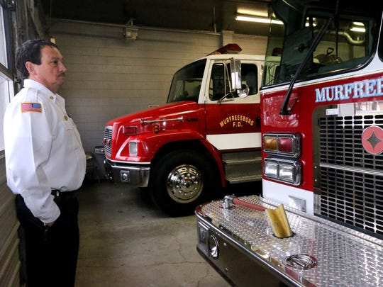 Murfreesboro Fire Chief Mark Foulks, shows of the dock at Fire Station 4 that is currently too small to house the larger ladder trucks, during a tour of the building onThursday, Feb. 25, 2016.