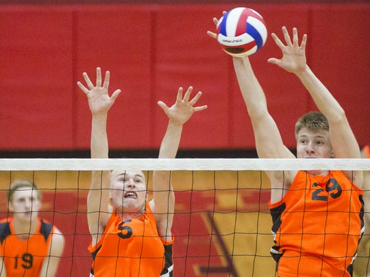 York Suburban's Kaleb Ansell, left, and Jack Schultz defend the net Wednesday against The Academy at Palumbo.