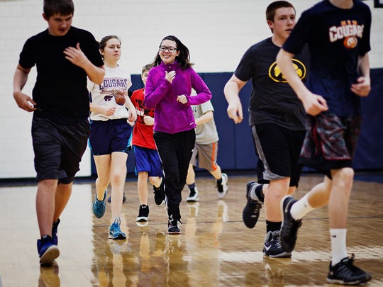 Alexis Myers runs laps at Manson Northwest Webster school during gym class on Friday, March 11, 2016, in Manson, Ia.