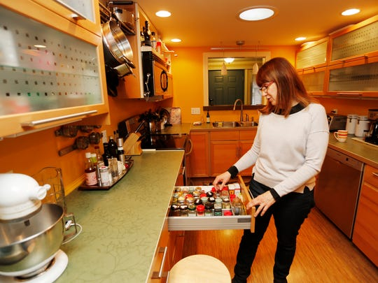 Diane Damico shows the spice drawer in the kitchen