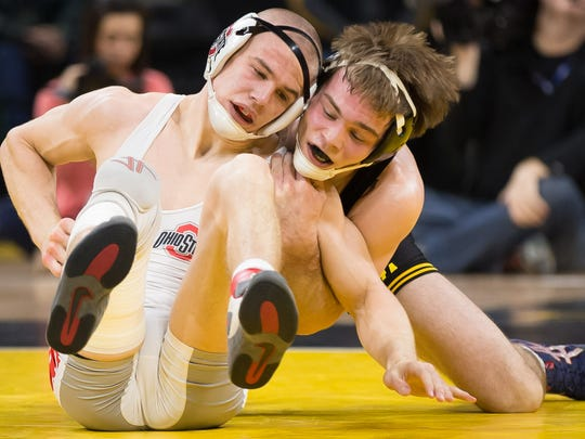 Brandon Sorensen of Iowa, right, seen in a file photo, demonstrated a championship-quality aggressiveness vs. Oklahoma State on Sunday.