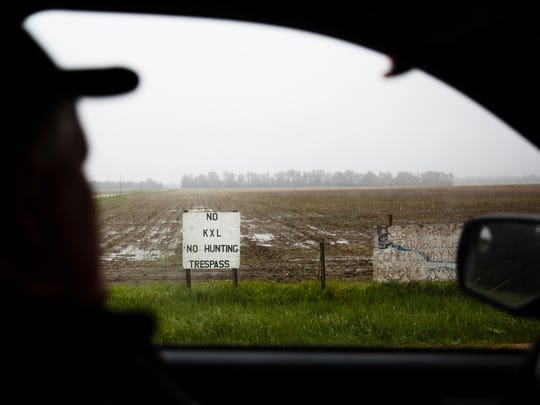 Farmer and Rancher Ron Crumly surveys his neighbors land as he drives back to his farm on Saturday, May 20, 2017, in O'Neill.