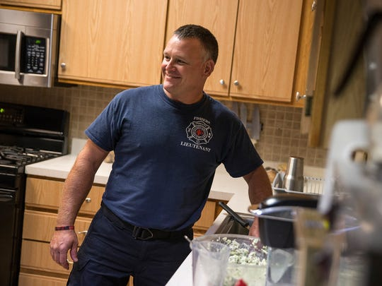 Lt. Brandon Anderson laughs with a fellow firefighter while cleaning up the kitchen at Fishers Fire Department station 93, Fishers, Ind., Wednesday, Sept. 6, 2017. Anderson lost his right leg in a motorcycle accident in August of 2016, and returned to work at the Fishers Fire Department in May of 2017, with an above-the-knee prosthetic leg. Anderson has passed physical agility tests and is able to perform his medical, firefighting and emergency duties as efficiently as before the accident.