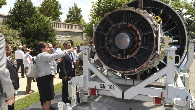 Visitors look over a Geared Turbofan engine built by Pratt & Whitney, a division of United Technologies, on Capitol Hill July 19, 2017 in Washington, D.C. The engine, with more than 8,000 on order, will help drive hiring up to 25,000 new employees, at Pratt & Whitney through 2026, and was showcased as an example of U.S. manufacturing leadership.