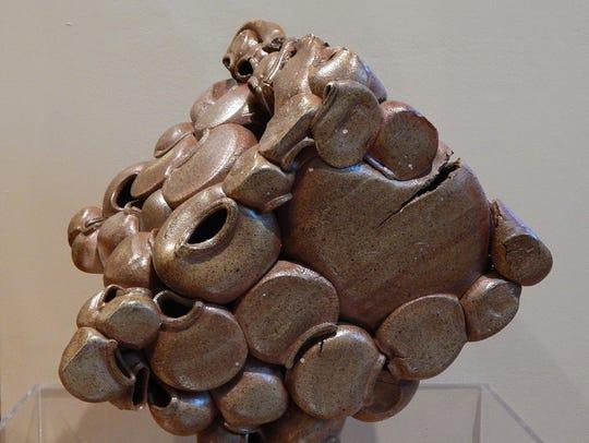 """""""Eclipse"""" is a stoneware piece by Nick Boismenu."""