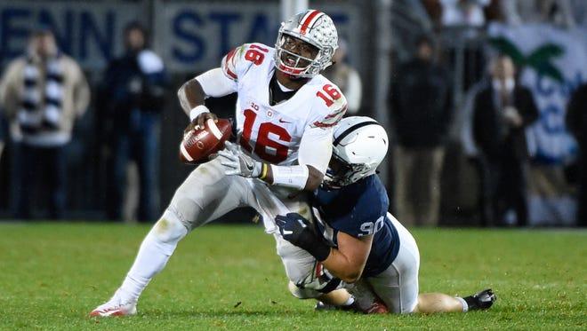 Penn State Nittany Lions defensive end Garrett Sickels (90) sacks Ohio State Buckeyes quarterback J.T. Barrett (16) during the third quarter at Beaver Stadium on Oct. 22.