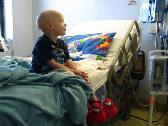 A young Garrett Semenetz sits in the hospital while undergoing chemotherapy.