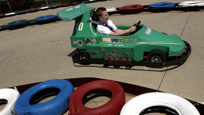 A customer drives a go-kart at Marker's Wally World in Liberty, Ind. in this file photo from 2003.