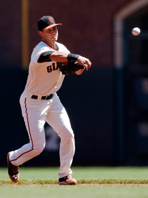 San Francisco Giants second baseman Joe Panik, a Hopewell Junction native, throws to first for the third out of the first inning against the Milwaukee Brewers at AT&T Park on Sunday.