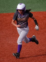 Kirtland Central's Tiana Aspaas races to third base